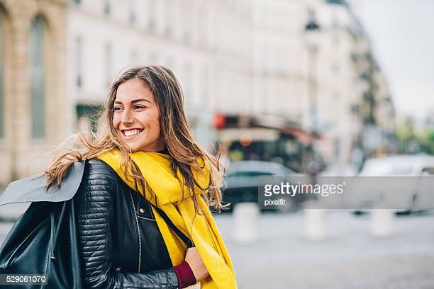 Young woman with a backpak in the city