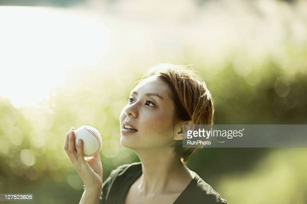 young woman with a baseball near the lake - 見上げる ストックフォトと画像