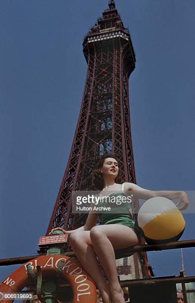 A young woman with a beach ball in front of Blackpool Tower in Blackpool Lancashire UK 23rd June 1955