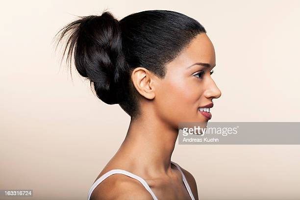 Young woman with a braided updo, profile.