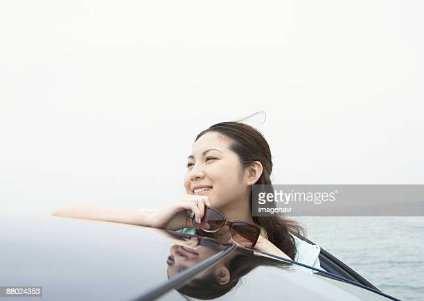 A young woman with a car