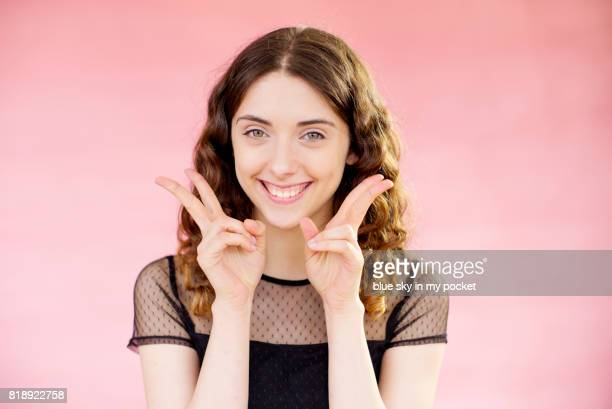 a young woman with a cheeky face. - wavy hair stock pictures, royalty-free photos & images