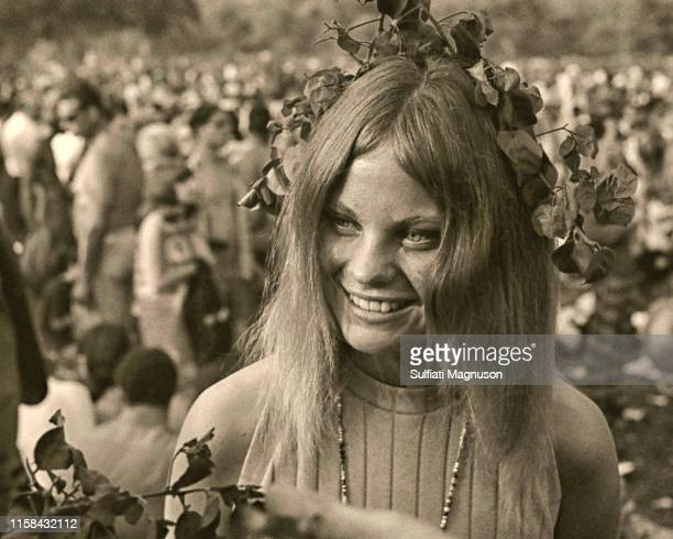 Young woman with a crown of bouganvilla flowers and a string of beads at the 1st Elysian Park Love-In on March 26, 1967 in Los Angeles, California.