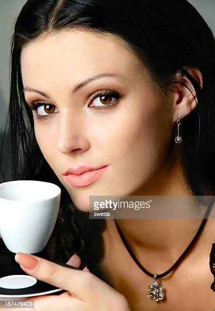 Young woman with a cup of coffee .
