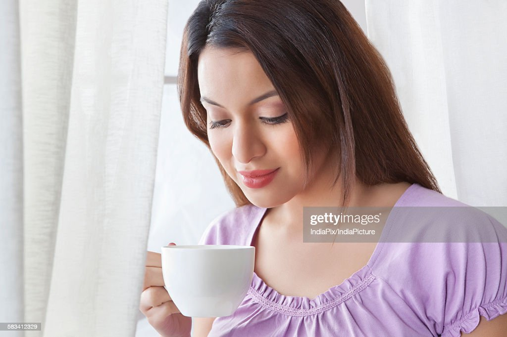 Young woman with a cup of coffee : Stock Photo