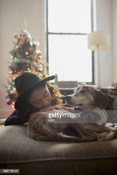 A young woman with a dog on a couch