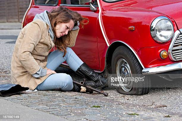 young woman with a flat tire - flat tire stock pictures, royalty-free photos & images