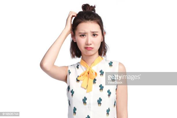 頭を掻く 女性 ストックフォトと画像 Getty Images