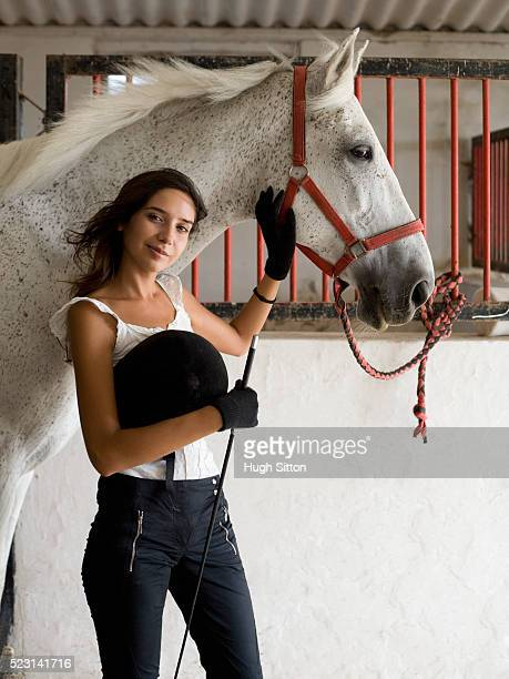 young woman with a horse - hugh sitton stock pictures, royalty-free photos & images