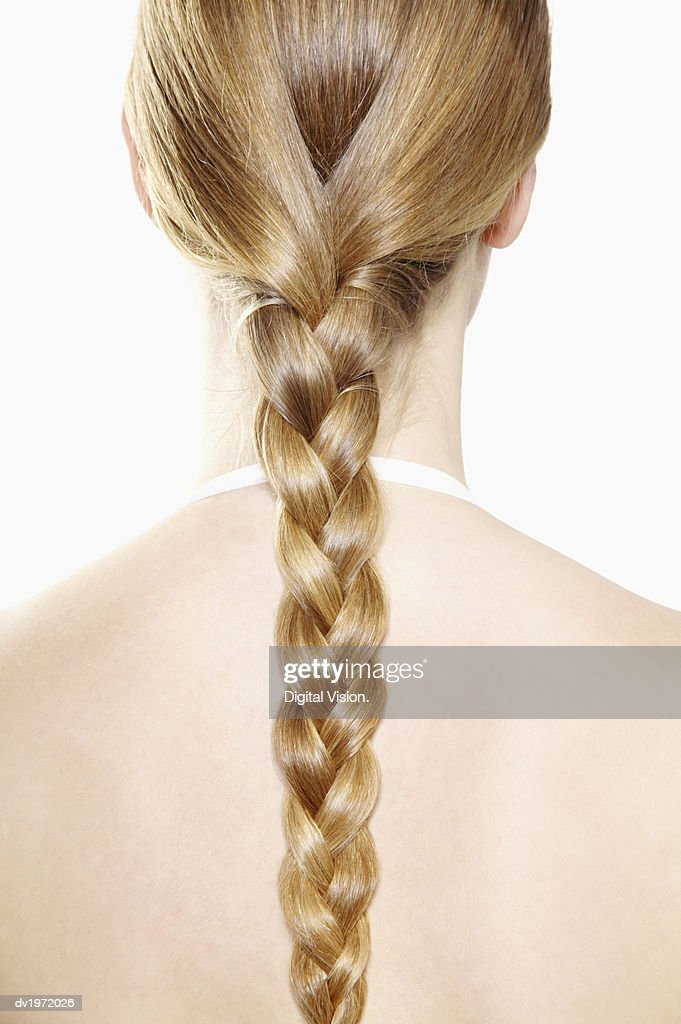 Young Woman With a Long Ponytail : Stock Photo