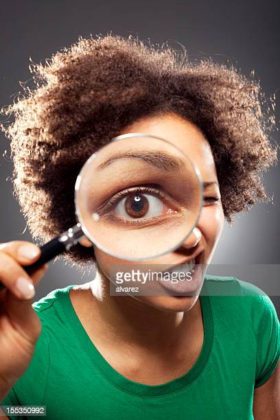 Young woman with a loupe