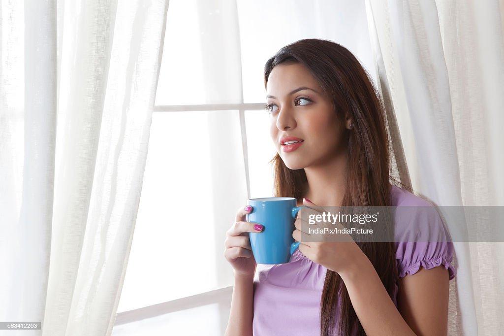 Young woman with a mug of tea : Stock Photo