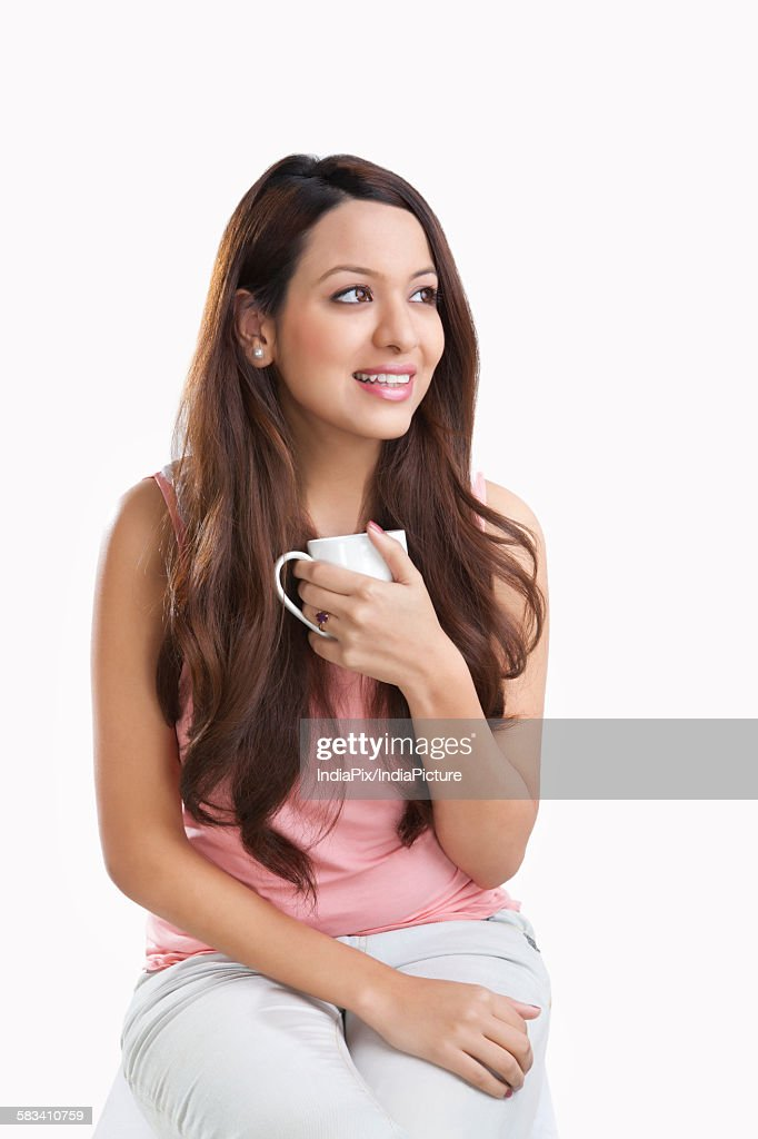 Young woman with a mug smiling : Stock Photo