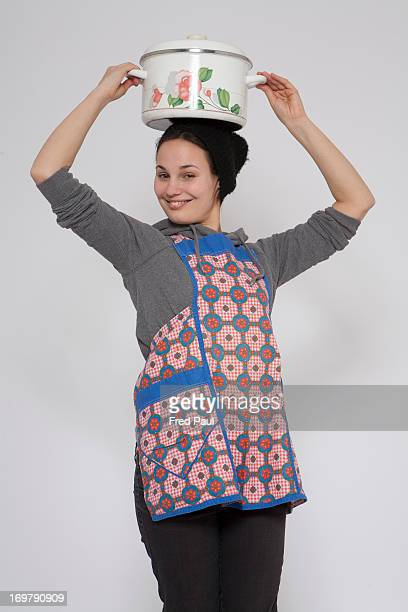 Young woman with a pot on her head