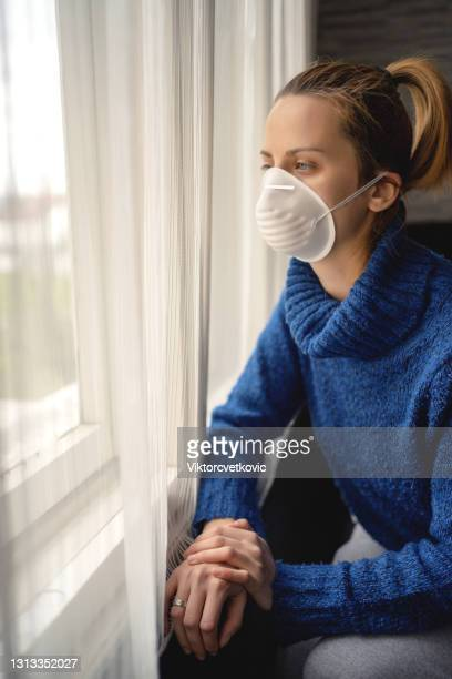 a young woman with a protective mask at home in isolation - audience free event stock pictures, royalty-free photos & images