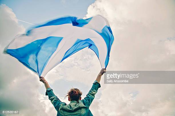 Young woman with a Scottish flag