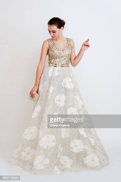 young woman with a stylish and elegant white dress - ロングドレス ストックフォトと画像