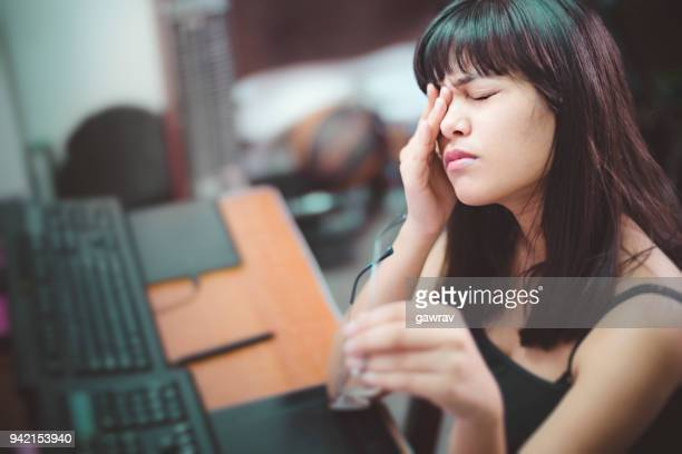 young woman with aching eyes after working on computer. - bloodshot stock pictures, royalty-free photos & images
