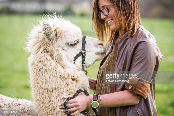 Young woman with an Alpaca