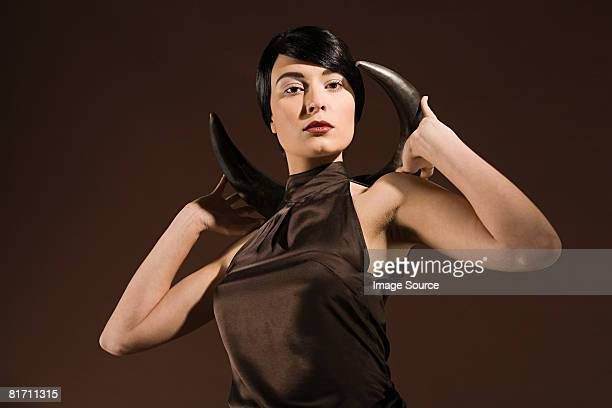 Young woman with animal horn