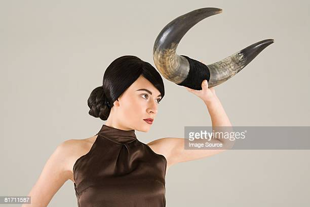 young woman with animal horn - bull animal stock photos and pictures
