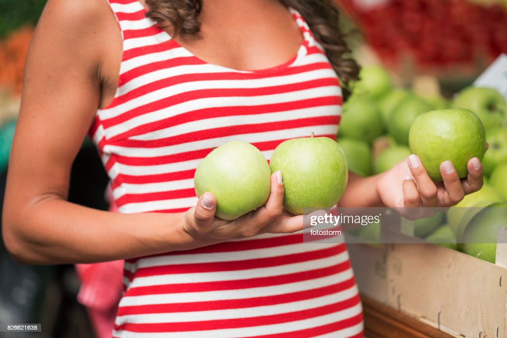 Young woman with apples : Stock Photo
