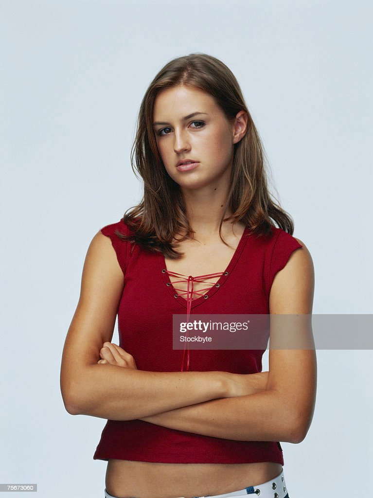 Young woman with arms crossed, portrait : Stock Photo