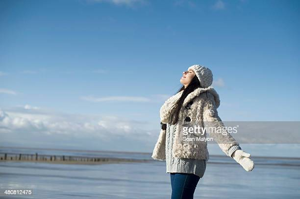young woman with arms out, brean sands, somerset, england - sean malyon stock pictures, royalty-free photos & images