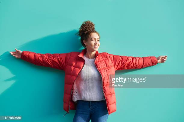 young woman with arms outstretched. - arms outstretched stock pictures, royalty-free photos & images
