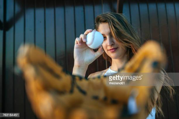 young woman with baseball and baseball glove - キャッチャー ストックフォトと画像