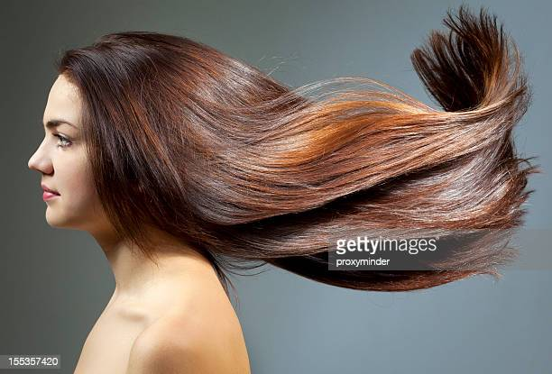young woman with beautiful hair - lang haar stockfoto's en -beelden