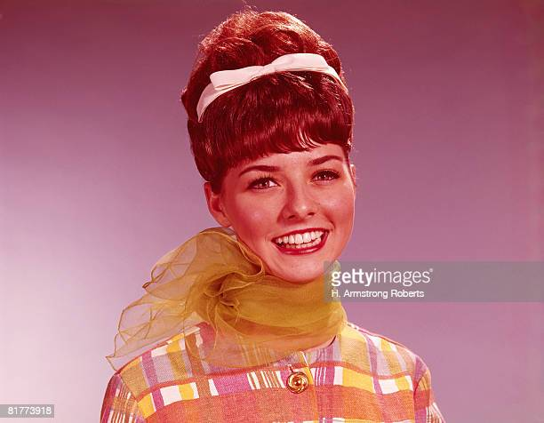 young woman with beehive hairdo. (photo by h. armstrong roberts/retrofile/getty images) - beehive hair stock pictures, royalty-free photos & images