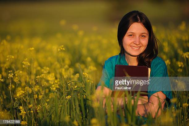 young woman with bible - free bible image stock pictures, royalty-free photos & images