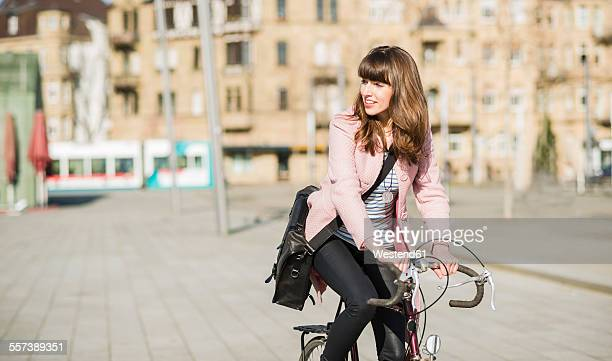 Young woman with bicycle in the city