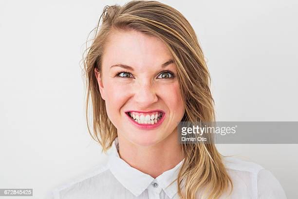 Young woman with big grin, grimace