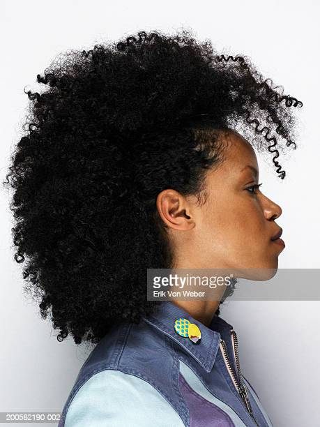 young woman with big hair, looking away, close-up - big hair stock pictures, royalty-free photos & images