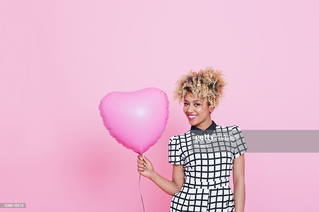 Young woman with big pink heart : Stock Photo