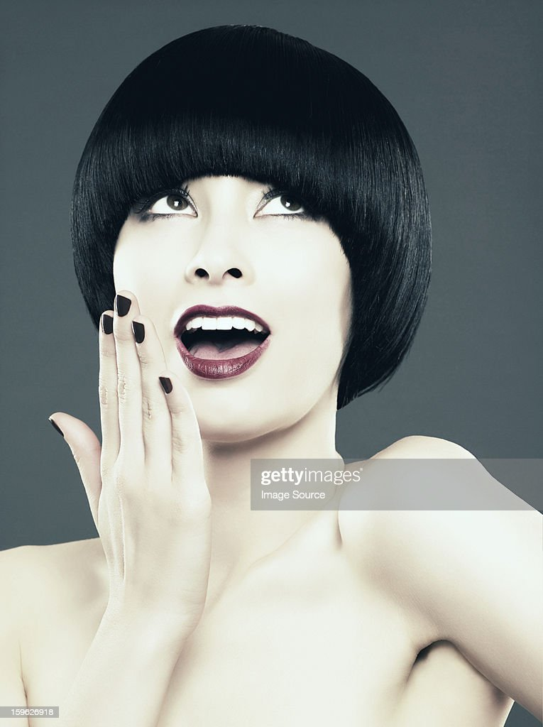 Young woman with black bob gasping : Stock Photo