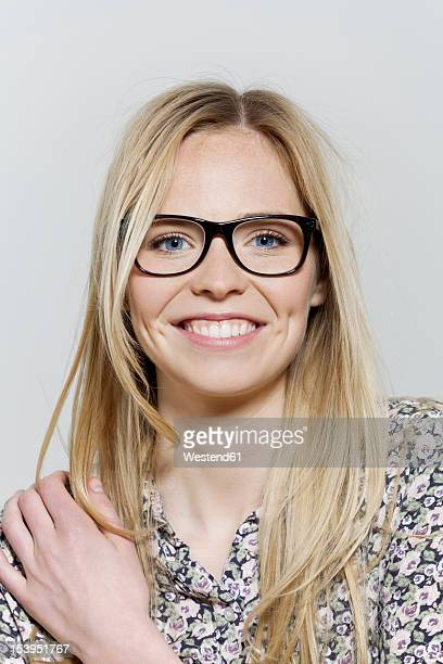 young woman with black rim glasses, portrait - jeune femme blonde photos et images de collection