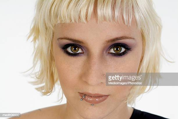 young woman with bleached blonde hair and face piercings, close-up - bleached hair stock photos and pictures