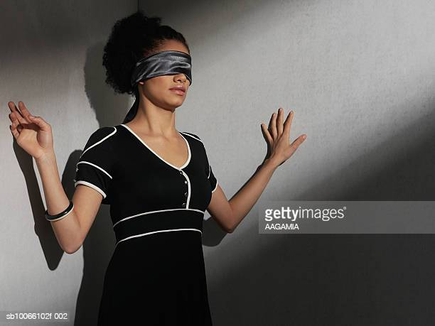 young woman with blindfold, arms raised - donna bendata foto e immagini stock
