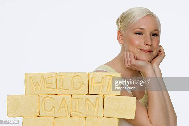 Young woman with blocks of butter