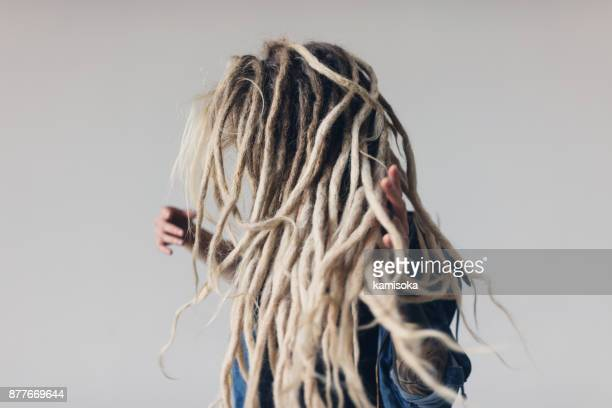 Young woman with blond dreadlocks