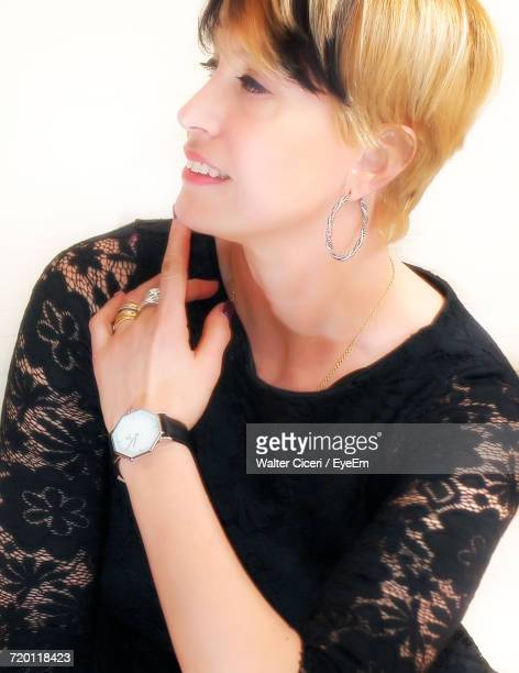young woman with blond hair in black dress against white background - walter ciceri foto e immagini stock