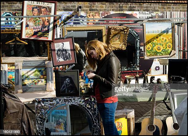 CONTENT] Young woman with blonde hair and wearing a leather jacket and jeans looking at bricabrac A sunny autumn Saturday morning at Portobello Road...