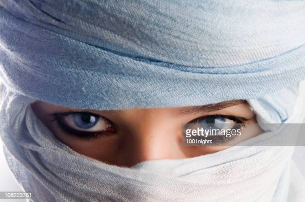 young woman with blue eyes wearing headscarf - veil stock photos and pictures