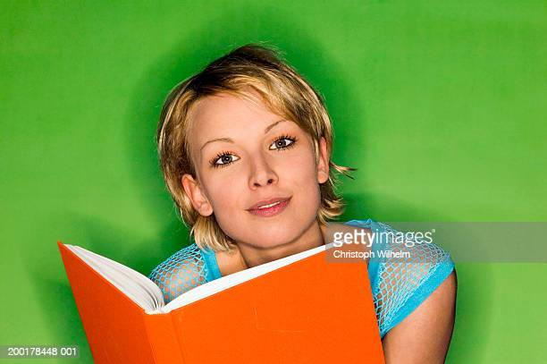 young woman with book, portrait, close-up - mesh shirt stock photos and pictures