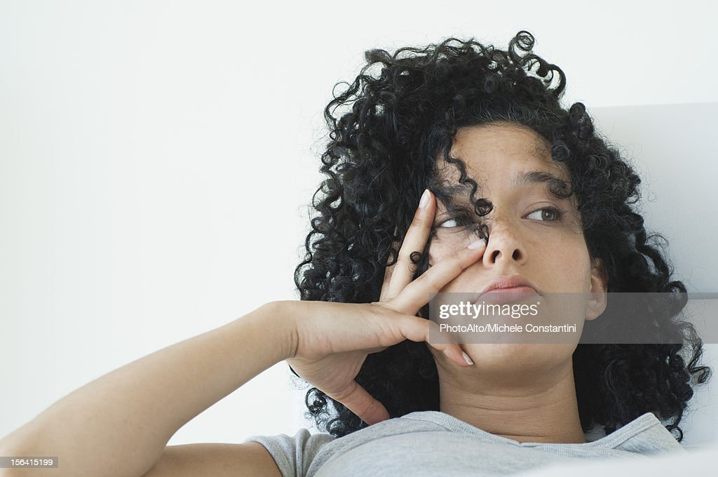 Young woman with bored expression on face : Stock Photo
