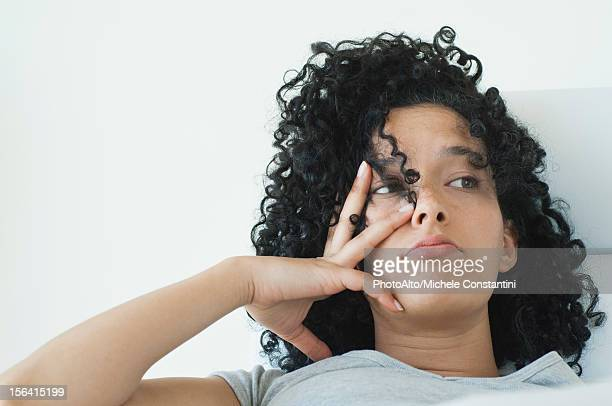 young woman with bored expression on face - wasting time stock pictures, royalty-free photos & images