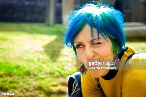 Young woman with bright blue hair